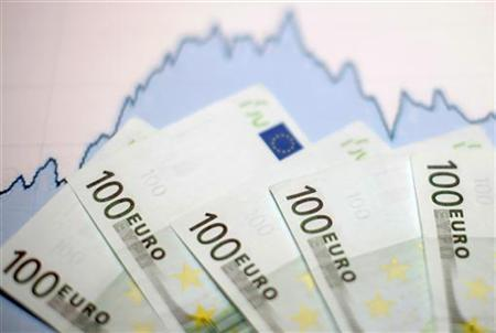 Euro banknotes are placed on a currency graph in this picture illustration taken January 22, 2011. REUTERS/Dado Ruvic