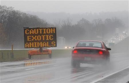 A sign posted on Interstate 70 warns drivers of animals loose in the area around Zanesville, Ohio October 19, 2011. REUTERS/Matt Sullivan