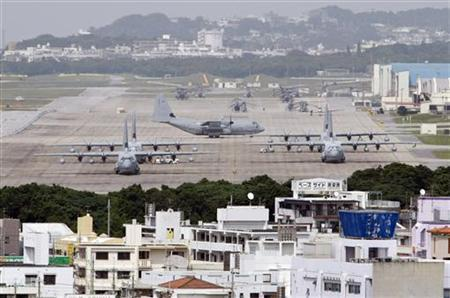 Hercules aircraft are parked on the tarmac at Marine Corps Air Station Futenma in Ginowan on Okinawa May 3, 2010. REUTERS/Issei Kato