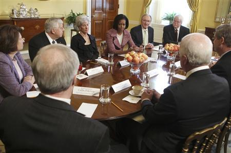 U.S. first lady Michelle Obama (C) holds a meeting on childhood obesity with Secretary of HHS Kathleen Sebelius (L), Senator Tom Harkin (R) and other officials at the White House in Washington in this February 2, 2010 file photo. REUTERS/Larry Downing/Files