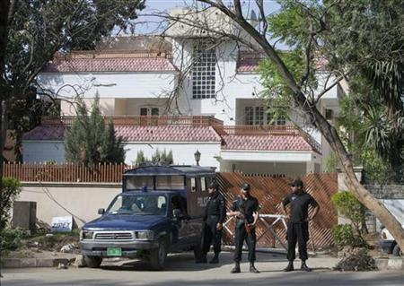 Pakistani policemen stand guard outside the house where bin Laden's family is believed to be detained in Islamabad April 2, 2012. REUTERS/Faisal Mahmood