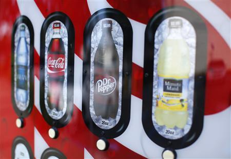 A soda vending machine is shown at a transit stop in Encinitas, California April 24, 2012. REUTERS/ Mike Blake