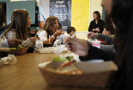 Students eat lunch in the cafeteria at Marston Middle School in San Diego, California March 7, 2011. REUTERS/ Mike Blake