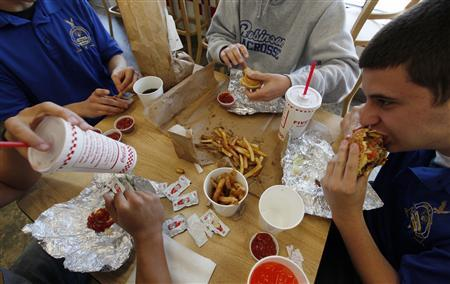 High school students eat burgers and fries at a fast food restaurant in Fairfax, Virginia April 25, 2012. REUTERS/Kevin Lamarque