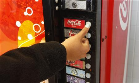 A student selects a soda at a machine inside a Northern Virginia high school April 24, 2012. REUTERS/Kevin Lamarque