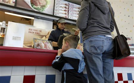 A boy and his mother await their order at a fast food restaurant in Manassas, Virginia April 24, 2012. REUTERS/Kevin Lamarque