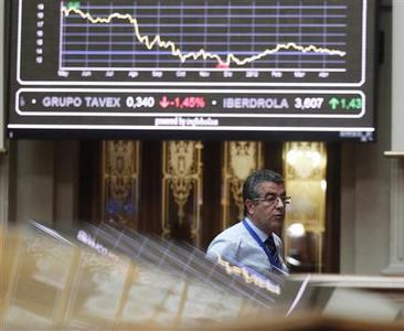 A trader walks under a chart at a bourse in Madrid April 27, 2012. Spain's sickly economy faces a ''crisis of huge proportions'', a minister said on Friday, as unemployment hit its highest level in two decades and Standard and Poor's weighed in with a two-notch downgrade of the government's debt. Spain's unemployment rate shot up to 24 percent in the first quarter, the highest level since the early 1990s and one of the worst jobless figures in the world. REUTERS/Andrea Comas