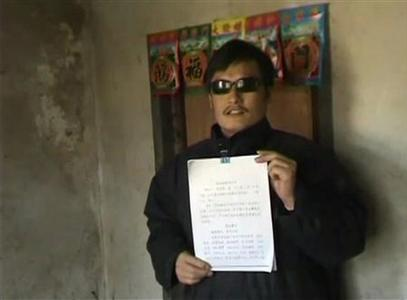 Blind legal activist Chen Guangcheng holds a petition in his village home in Linyi in eastern Shandong province, in this still image taken from file video. Chen, one of China's most prominent human rights advocates, has escaped from home imprisonment, activists said on April 27, 2012, but uncertainty over his whereabouts and fears about his health have worried supporters. Chen, a self-schooled legal advocate who campaigned against forced abortions, had been restricted to his home since September 2010 when he was released from jail. REUTERS/Chinaaid via Reuters TV/Handout