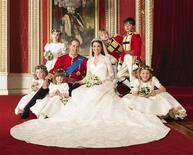 Britain's Prince William and his bride Catherine, Duchess of Cambridge, pose for an official photograph, with their bridesmaids and pageboys, on the day of their wedding, in the throne room at Buckingham Palace, in central London April 29, 2011. REUTERS/Hugo Burnand/Clarence House/Handout