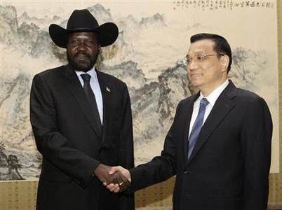South Sudan's President Salva Kiir Mayardit (L) shakes hands with Chinese Vice Premier Li Keqiang at Zhongnanhai in Beijing April 25, 2012. REUTERS/Kazuhiro Ibuki/Pool
