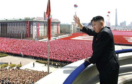 North Korean leader Kim Jong-Un waves his hand to the people during a military parade held to celebrate the centenary of the birth of the North's founder Kim Il-Sung in Pyongyang April 15, 2012 in this picture released by the North Korea's KCNA on April 16, 2012. REUTERS/KCNA