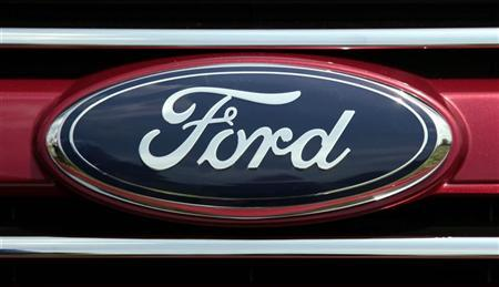 A Ford logo is pictured at a press event to unveil the new 2011 Ford Explorer outside the Ford Motor World Headquarters in Dearborn, Michigan July 26, 2010. REUTERS/Rebecca Cook
