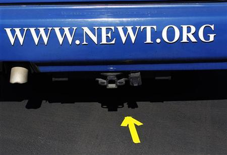 An arrow points to the back of U.S. Republican presidential candidate and former Speaker of the House Newt Gingrich's campaign bus during a rally in The Villages, Florida January 29, 2012. REUTERS/Shannon Stapleton