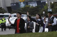 Christians attend a prayer meeting against the concert of U.S. singer Lady Gaga, in front of the Olympic stadium in Seoul April 27, 2012. Christian groups called for a boycott of her show, which they say promotes homosexuality. REUTERS/Kim Hong-Ji