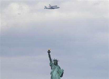 The Space Shuttles Enterprise rides atop a NASA modified 747 plane over the Statue of Liberty in New York, April 27, 2012. The Space Shuttle Enterprise officially arrives in New York to be placed at the Intrepid Sea, Air and Space Museum. REUTERS/Brendan McDermid