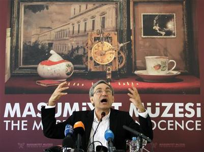 Nobel-winning Turkish author Orhan Pamuk gestures during a news conference before the opening of the Museum of Innocence in Istanbul April 27, 2012. REUTERS/Osman Orsal