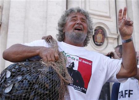 Comic and political activist Beppe Grillo gestures before dumping rotten mussel shells in front of the Parliament in Rome September 10, 2011. REUTERS/Alessia Pierdomenico