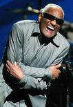 "Singer Ray Charles, performing in this April 9, 2003 file photograph, has received seven Grammy Award nominations posthumously, as nominations were announced at a news conference in Hollywood by the Academy of Recording Arts & Sciences December 7, 2004. Charles died at his home in Beverly Hills June 10, 2004. Charles album ""Genius Loves Company"" was nominated for Album of the Year. REUTERS/Jeff Christensen/Files"