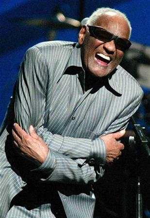 Singer Ray Charles, performing in this April 9, 2003 file photograph, has received seven Grammy Award nominations posthumously, as nominations were announced at a news conference in Hollywood by the Academy of Recording Arts & Sciences December 7, 2004. Charles died at his home in Beverly Hills June 10, 2004. Charles album ''Genius Loves Company'' was nominated for Album of the Year. REUTERS/Jeff Christensen/Files