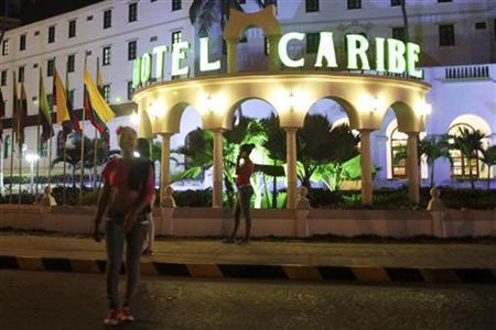 Prostitutes walk in front of the Hotel Caribe in Cartagena in this April 17, 2012 file photo. REUTERS/Stringer