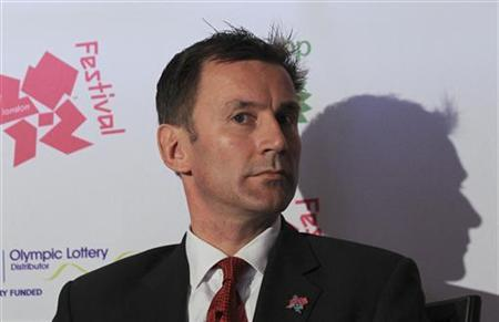 Britain's Culture minister, Jeremy Hunt, listens during the launch of the London 2012 Cultural Olympiad at the Tower of London April 26, 2012. REUTERS/Olivia Harris
