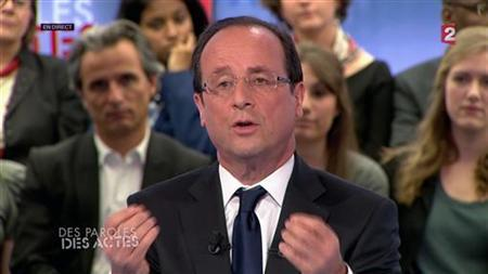 Francois Hollande, Socialist party candidate for the 2012 French presidential elections, seen in this video grab image from France 2 public television programme ''Des Paroles et Des Actes'' appears at their studios in Paris April 26, 2012. REUTERS/France 2 Televions/Handout
