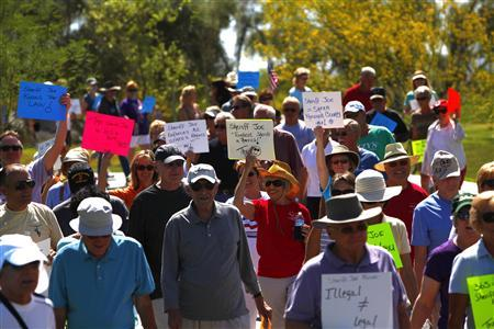 Supporters of Maricopa County Sheriff Joe Arpaio hold a rally at a park in Fountain Hills, Arizona April 28, 2012. REUTERS-Eric Thayer