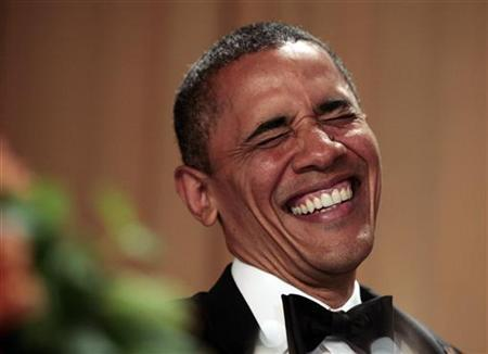 U.S. President Barack Obama laughs at comedian Jimmy Kimmel at the White House Correspondents Association annual dinner in Washington April 28, 2012. REUTERS/Larry Downing