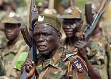Soldiers of South Sudan's SPLA army shout at a military base in Bentiu April 22, 2012. REUTERS/Goran Tomasevic