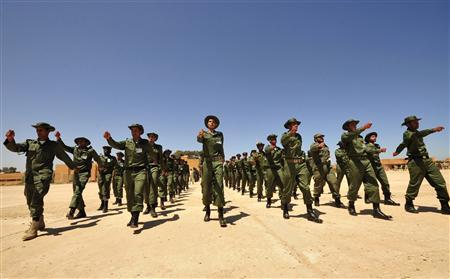 Recruits of the first rocket brigade of the Libyan National Army march during a graduation parade in Benghazi April 28, 2012. REUTERS/Esam Al-Fetori