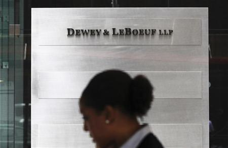 A woman walks by the Dewey & LeBoeuf LLP headquarters on 6th avenue in New York April 20, 2012. REUTERS/Shannon Stapleton