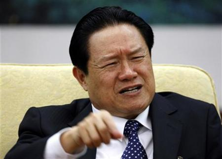 China's Public Security Minister Zhou Yongkang gestures as he attends Hebei delegation discussion sessions of the 17th National Congress of the Communist Party of China in Beijing October 16, 2007. REUTERS/Jason Lee/Files