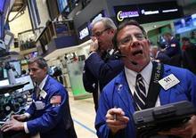 Traders work on the floor of the New York Stock Exchange, April 25, 2012. REUTERS/Brendan McDermid