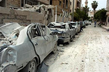 A view of damaged cars at the site where two bombs detonated near state buildings in the northern city of Idlib in this handout released by Syria's national news agency SANA on April 30, 2012. REUTERS/SANA/Handout