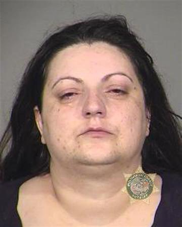 Rasema Handanovic, an Oregon woman, is seen in this Multnomah County, Oregon, Sheriff's Office booking photograph released to Reuters April 13, 2011. REUTERS/Multnomah County Sheriff's Office/Handout