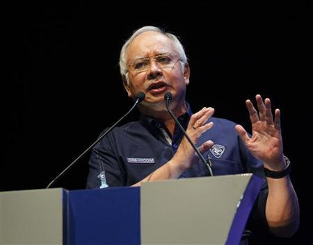 Malaysia's Prime Minister Najib Razak delivers his speech during the launch of the new Malaysia-made Proton Preve in Kuala Lumpur April 16, 2012. REUTERS/Bazuki Muhammad
