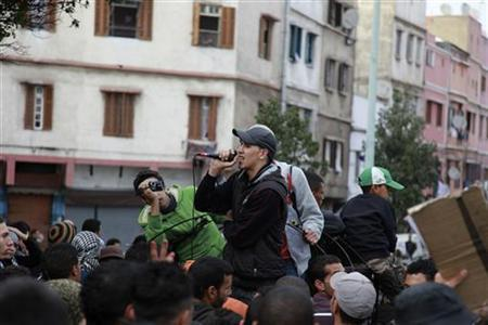 Moroccan rapper Mouad Belrhouat (C) performs during a demonstration in Casablanca March 18, 2012. REUTERS/Macao