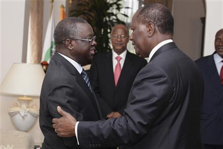 Ivory Coast President Alassane Ouattara (R) welcomes former Guinea-Bissau Interim President Raimundo Pereira in Abidjanis April 28, 2012. REUTERS/ Thierry Gouegnon