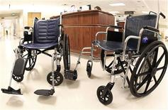 A regular sized wheelchair (L) is pictured alongside an oversized one in the children's and women's maternity ward at the University of Alabama Hospital in Birmingham, Alabama, April 26, 2012. OBESITY/ REUTERS/Marvin Gentry