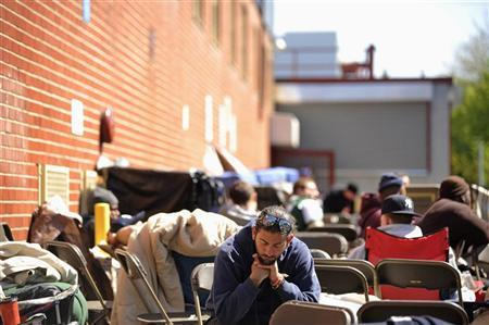 Job seekers wait in front of the training offices of Local Union 46, the union representing metallic lathers and reinforcing ironworkers, in the Queens borough of New York, April 29, 2012. REUTERS/Keith Bedford