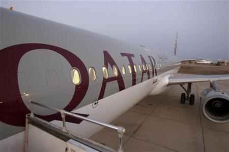 A Qatar Airways plane is seen at Aden International Airport November 29, 2010. REUTERS/Fadi Al-Assaad