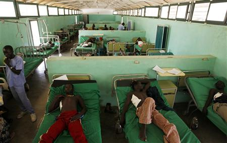 Sudan People's Liberation Movement (SPLA-N) rebel soldiers lie in a hospital in Gidel village April 30, 2012. REUTERS/Goran Tomasevic