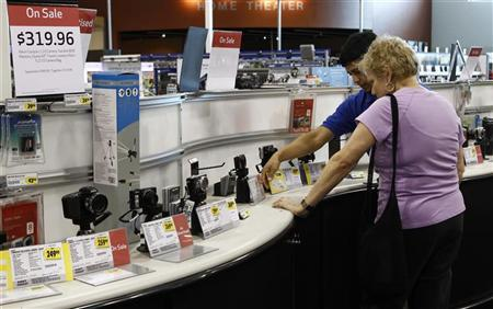 A shopper is shown a camera in an electronics store in Falls Church, Virginia May 28, 2010. REUTERS/Kevin Lamarque