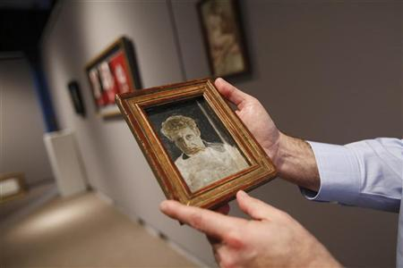 Impressionist art expert David Norman holds artist Lucian Freud's ''Self Portrait'' at Sotheby's before its preview exhibition of highlights from its upcoming London sale of Impressionist Modern and Contemporary art in New York January 10, 2011. REUTERS/Shannon Stapleton