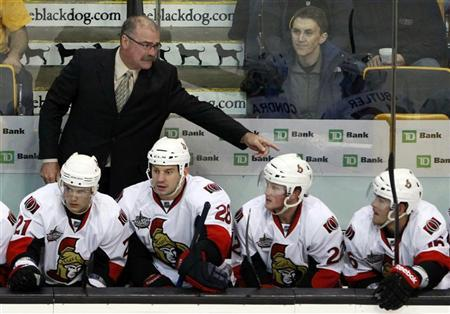 Ottawa Senators head coach Paul MacLean talks to his players on the bench in the third period of their NHL pre-season hockey game against the Boston Bruins in Boston, Massachusetts September 29, 2011. REUTERS/Brian Snyder