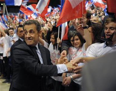 France's President and UMP party candidate for the French 2012 presidential elections Nicolas Sarkozy (L) arrives for his re-election campaign rally in Dijon April 27, 2012. REUTERS/Philippe Wojazer