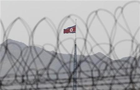 A North Korean flag flutters on top of a tower at the propaganda village of Gijungdong in North Korea in this photo taken from Observation Post Ouellette after U.S. President Barack Obama's visit to the truce village of Panmunjom in the demilitarised zone (DMZ) separating the two Koreas, north of Seoul, March 25, 2012. REUTERS/Yuriko Nakao
