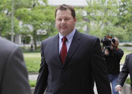 Former Major League Baseball pitcher Roger Clemens walks at the federal courthouse in Washington April 30, 2012. REUTERS/Yuri Gripas