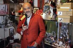 French shoe designer Christian Louboutin poses for photographs during a media viewing of his retrospective exhibition at the Design Museum in London April 30, 2012.REUTERS/Stefan Wermuth