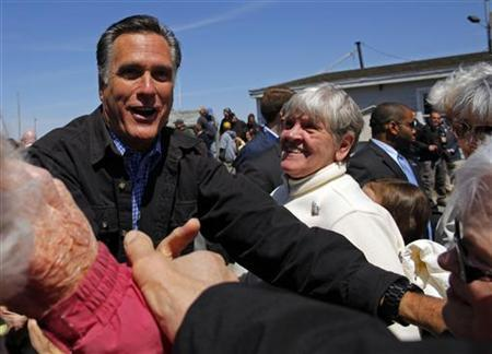 Republican presidential candidate and former Massachusetts governor Mitt Romney greets audience members during a campaign stop at the fish pier in Portsmouth, New Hampshire April 30, 2012. REUTERS/Brian Snyder